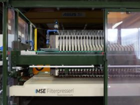 rubberised filter press with splash guard and monitored sliding doors